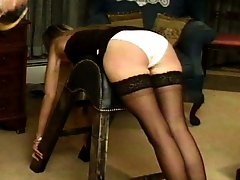 Three young women caned by their English mistress, some with panties, some without. She seems to...