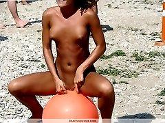 Photos of nudist girls at beach - series of shots