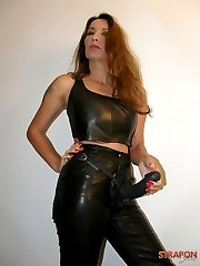 Jane posing in leather outfit and big strapon cock