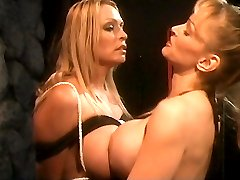 Busty blonde Domme Skye Blue bounds and seduces her stacked female submissive partner