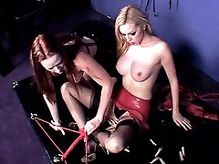 Sexy dominatrix Julie Simone bounds her sexy submissive partner and plays with her big boobs