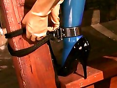 Latex mistress Jean Bardot gets her cute female slaves body and mouth stretched to the limit