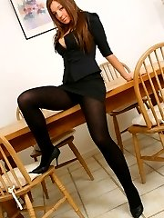 Sophisticated secretary in sexy thick black pantyhose.