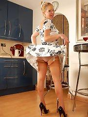 In her British suntan point heel full fashioned nylons, and slinky white sheer nylon panties,...
