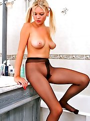 Pony-tailed chick posing in her black sheer-to-waist pantyhose in bathroom