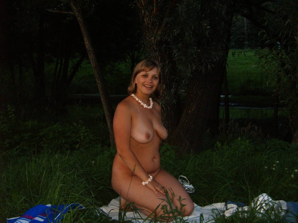 Girl in wet clothes showing naked