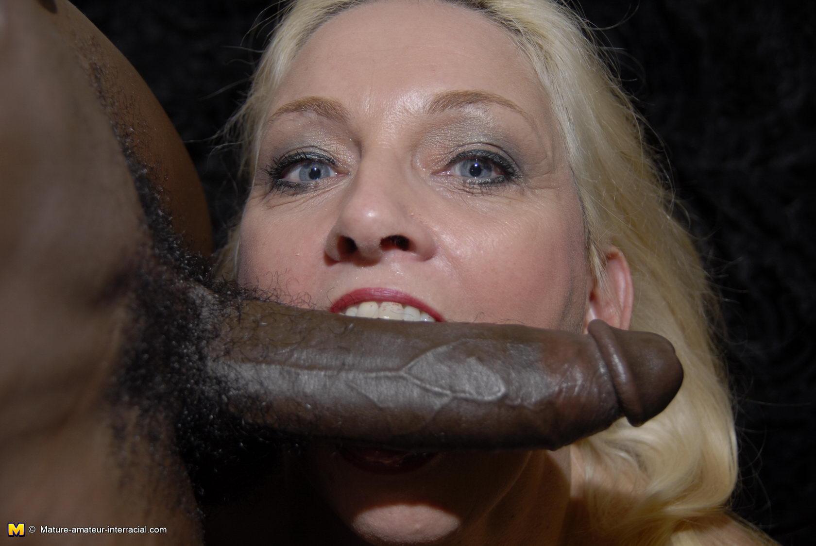 Mature loves sucking black cock