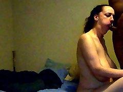 Huge Busty sucking a short sling fuck cock