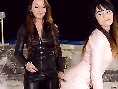 2 lesbians dominating in leather and boots durin force rim fetish