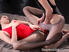 Lesbian Girl in Pantyhose and Leotard Strapon Fucks her GF