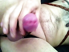 Masturbating in stockings and kinky leather straps...