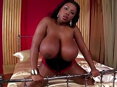 Ebony babe shows off her huge black tits