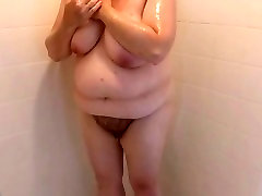 drying her hairy bush & big tittys after shower