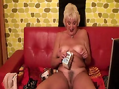 Mature Granny pouring Milk down her pussy.