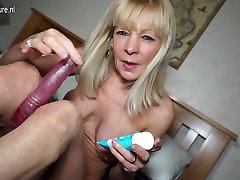 Naughty British mature lady playing with her dildo
