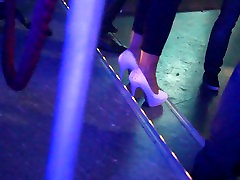 Candid dancing white high heels in a club