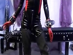 latex girl in chain bondage
