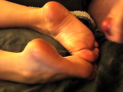 Cum on her oiled feet