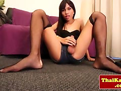 Posing asian tranny playing with her cock
