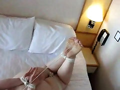 Hogtied nude girl toes tied to hair