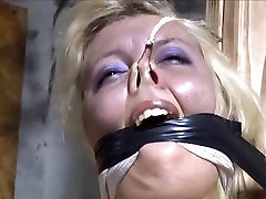 Humiliating bondage pose for a haughty blonde.