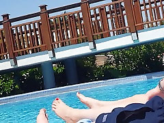 Teen macik jilbab at the Pool