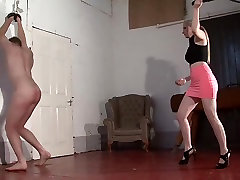 Two ladies whipping male slave