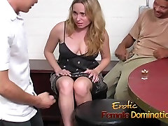 Slutty blonde dominatrix having fun playing with a slaves co