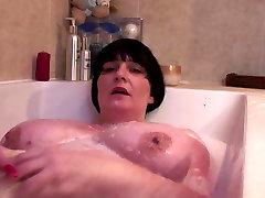Fat mature mom bating in bath