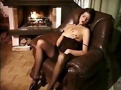 Brunette in stockings gives blowjob