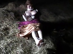 Medieval wench struggles in toetied hogtie in barn