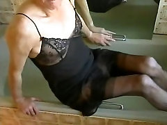 in the tub wearing a M&S black slip