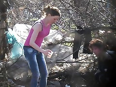 mother and daughter pissing road side