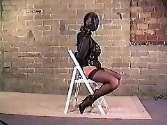 Busty Brunette in Black mom daughter forced gangbang Straightjacket and Armbinder