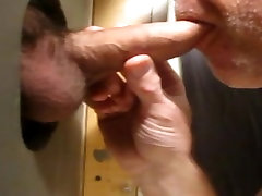 Hot sucking action at the homemade glory hole 4