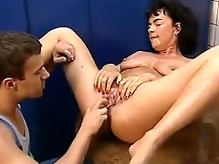 Sexy granny fisted by young dude