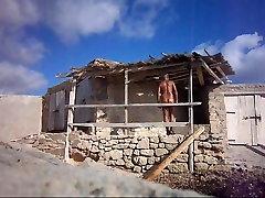 naked man at a fishing hut