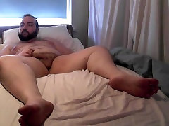 Bear shows feet on webcam