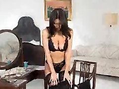 Black haired beauty fingering her pussy