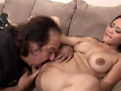 Porn star legend Ron Jeremy and a slutty Asian with big triple penetration in anal fuck on the sofa
