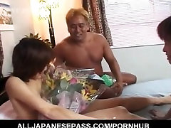 Tomomi gets flowers after is strongly pumped by two fellows
