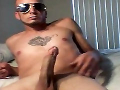 Tattooed fitness punk strokes huge cock to massive cumshot