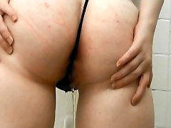 Pissing in a Cute GString Thong