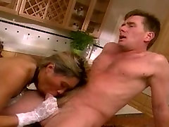 Asian whore in boots and gloves gets her pussy fucked in the kitchen counter top