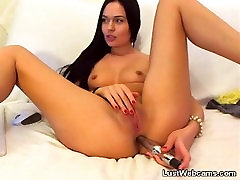 Ultra hot brunette dildoing her pussy and ass on webcam
