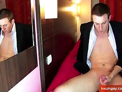 My straight bankster gets wanked his big cock by me in spite of him !