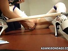 Voluptuous domina toy teasing the bound Asian slut