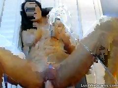 Busty hottie rides dildo on webcam