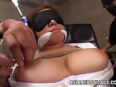 Asian office worker submited to a precise bdsm session