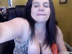 Squirting busty mom Roxi Lace penetrates a big hairy bush